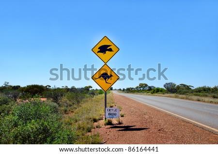 An Australian kangaroo & Eagle  warning sign on the side of a road in Western Australia