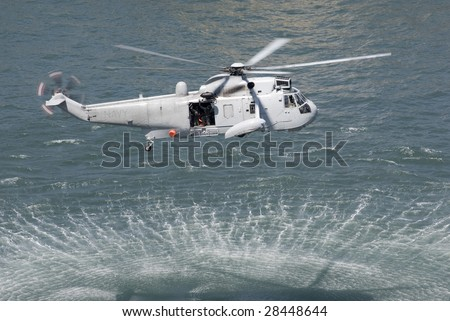 An Australian navy sea king helicopter practising a rescue