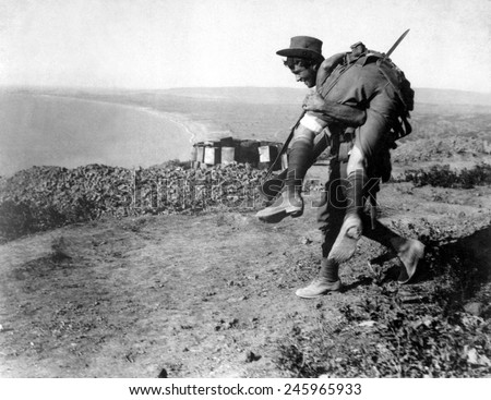 An Australian soldier carrying a wounded comrade during the WWI, Dardanelles Campaign. 1915.
