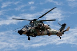 An Australian Tiger Helicopter hovering while on patrol