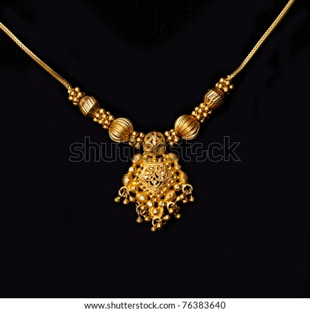 an authentic indian jewellery isolated on black background
