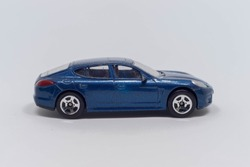 An auto sports toy in blue on a white background
