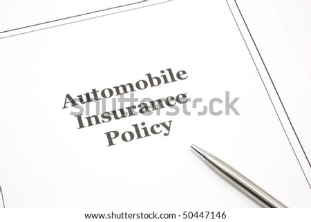 An automobile insurance policy with a pen ready to be signed.