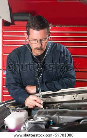 An automobile mechanic examines an engine for unusual sounds using a mechanic's stethoscope.