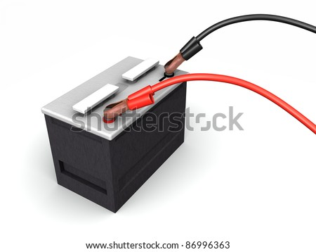 An automotive battery being recharged with battery cables sitting on a white surface