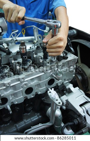an automotive mechanic tightening using torque wrench
