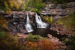 An autumn scene at Blackwater Falls, the namesake waterfall of Blackwater Falls State Park in Davis, West Virginia.