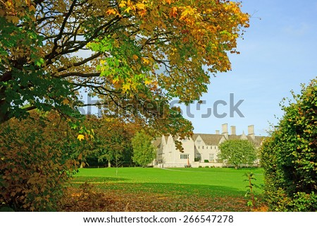 An Autumn view of a Cotswold country Mansion and gardens near to Painswick, Gloucestershire, United Kingdom