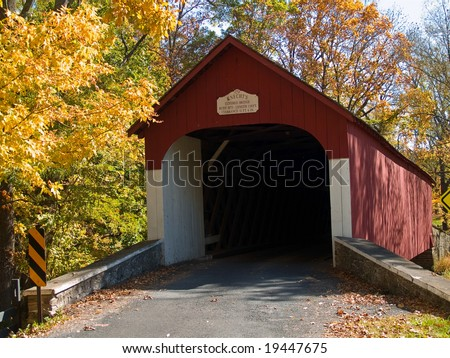 An Autumn view of the historic Knechts Covered Bridge in rural Bucks County, Pennsylvania.