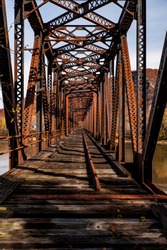 An autumn view of the long abandoned and now collapsing Coxton railroad bridge over the Susquehanna River in Luzerne County, Pennsylvania.
