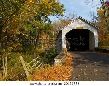 An Autumn  view of the Loux Covered Bridge located in Plumstead Township, Bucks County, Pa.