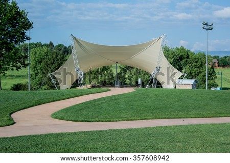 An awning covers an amphitheater in a public park #357608942