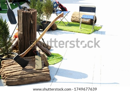 An axe is an implement that has been used for millennia to shape, split and cut wood, to harvest timber, as a weapon, and as a ceremonial or heraldic symbol. stock photo