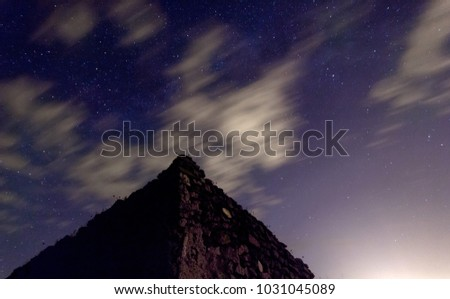 Stock Photo An aztec mexican zigurat under the stars during the night. An aztec pyramid under a starr sky.