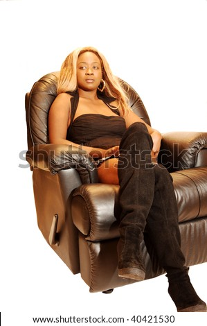 An Blond Young Jamaican Girl Sitting In Black Leather Chair A