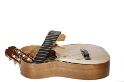 An broken classical acoustic guitar left in bits and pieces by its disillusioned musician owner, Now a really rubbish guitar. White background with copy space.