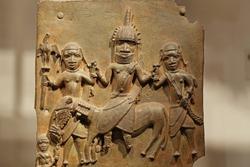 An bronze relief depicting ancient African warriors
