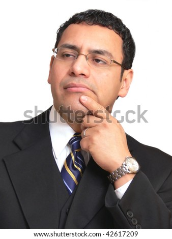 An businessman is thinking seriously about his next move in the company. - stock photo