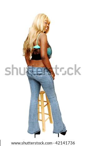stock photo An busty young Jamaican girl in jeans whit long blond hair and