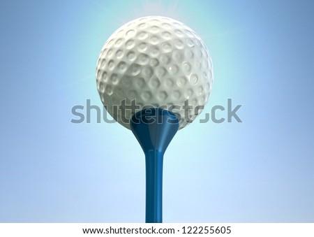 An closeup upward view of a regular golf ball on a blue golf tee on a blue sky background
