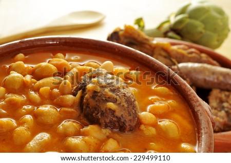 Shutterstock an earthenware bowl with potaje de judias y garbanzos, a traditional spanish legume stew