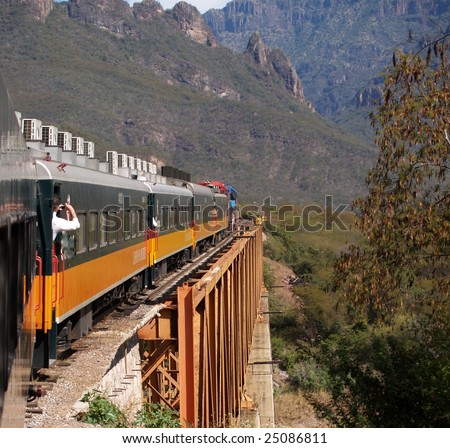 An eastbound Mexican passenger train winds its way up the Copper Canyon, climbing 6500' in a matter of 150 miles