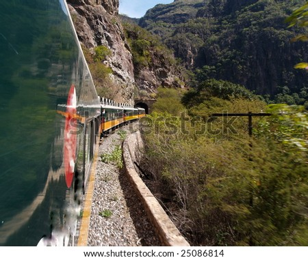 An eastbound Mexican passenger train winds its way up thr Copper Canyon, climbing 6500' in a matter of 150 miles