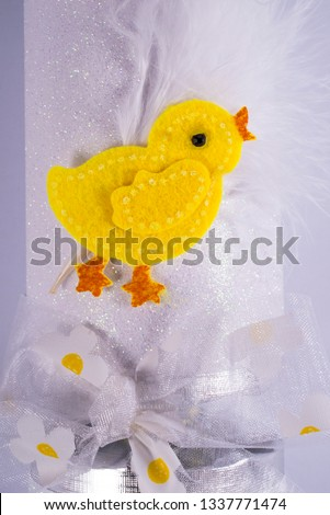 An Easter Chick decoration on a traditional Cracker or otherwise known as a Bon Bon.