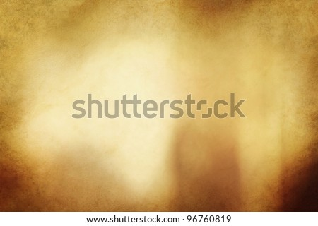 An eerie golden bronze colored grunge texture or background with space for text or image.