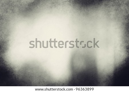 An eerie Image is a composite of my photos. No filters have been used. black and white grunge texture or background with space for text or image.