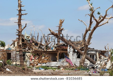 An EF-5 Tornado'd damage is evident in this image of a home which used to be surrounded by large shady oaks.  There is nothing left of the trees except a few broken limbs and the home was destroyed.