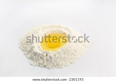 An egg in some flour preparing for baking