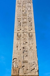 An Egyptian obelisk ( Flaminio Obelisk) of Ramesses II from Heliopolis with hieroglyphs in the centre of the Piazza del Popolo, Rome, Italy