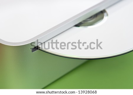 An ejected white CD on a green background