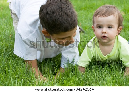 an elder brother is playing with his younger