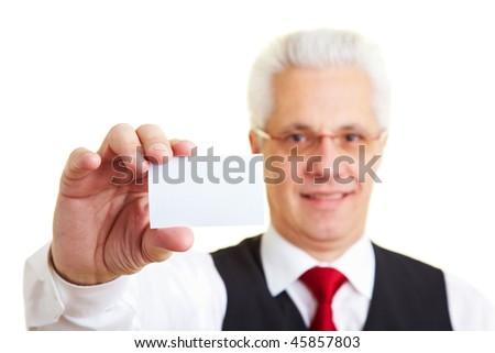 An elderly businessman holding his business card