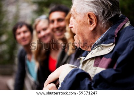 An elderly man telling stories