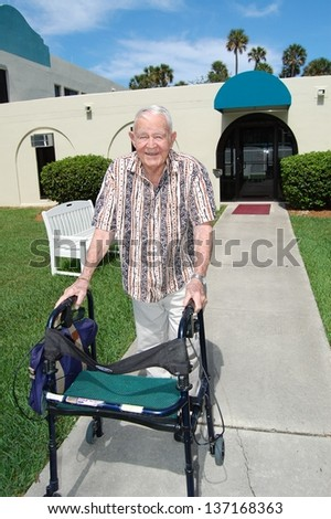 An elderly man with dementia enjoys the outdoors.