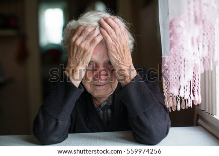An elderly woman in a state of depression.