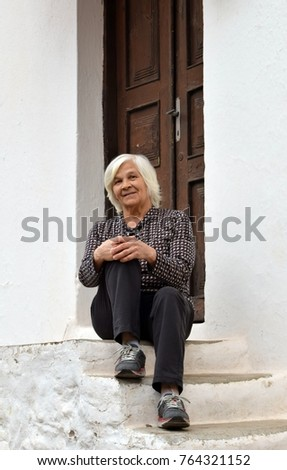 An elderly woman on the street.Portrait of an elderly woman