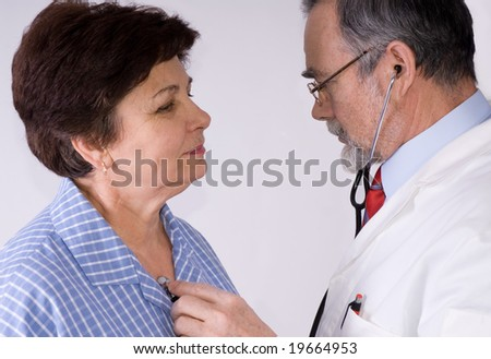 An elderly women being examined by a doctor
