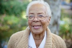 An elderly women smiling