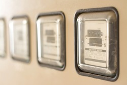 An electric meter measures power usage, records consumption of electric energy and communicates information to the utility for monitoring and billing.