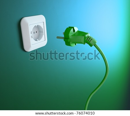 An electric plug and an outlet - stock photo