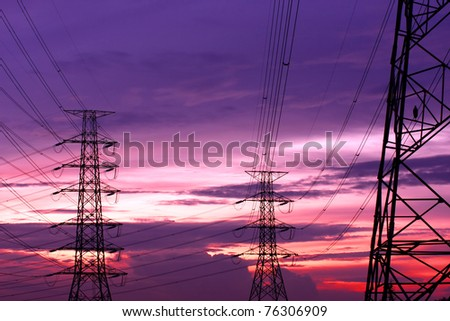 An Electric Pole With Sunset Sky