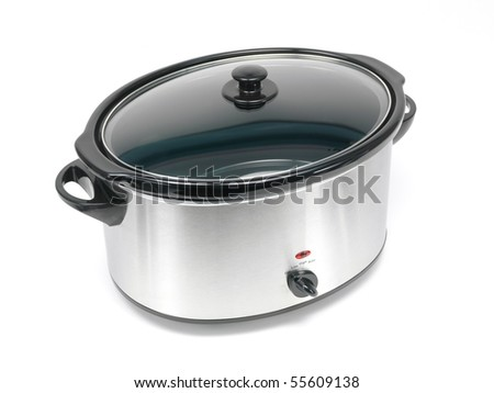 An electric slow cooker on a kitchen bench