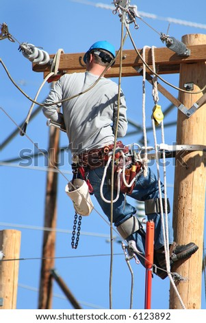 an electrical lineman working on lines