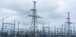 An electrical substation transmits electricity through a power line