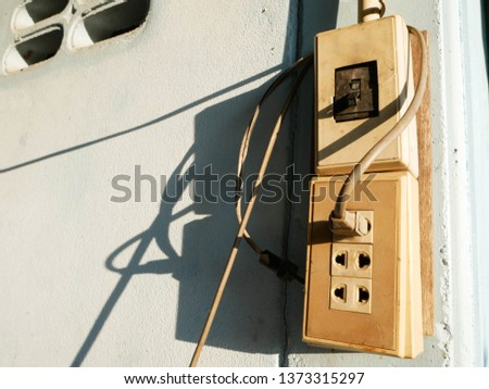 an electrical switch and a power outlet,, power switch, power outlet, Plug socket on the wall