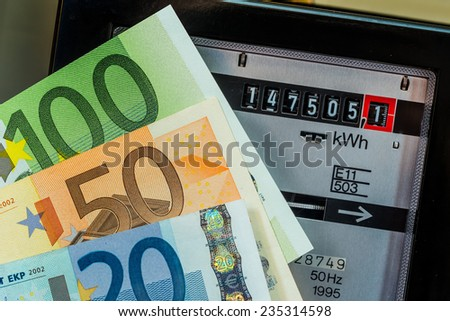 an electricity meter measures the electricity consumed. save symbolic photo for current price and current